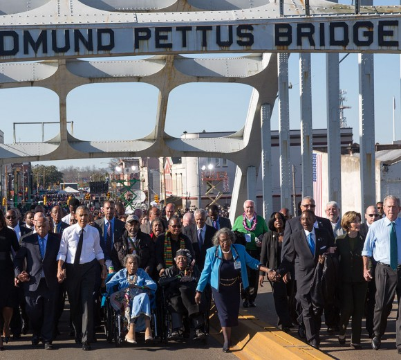 The Obamas and the Bushes continue across the bridge. (Official White House Photo by Lawrence Jackson)